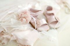 Baby girl christening shoes. And flower headband Stock Photos