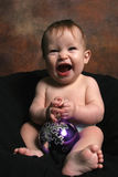 Baby Girl with Christmas Blub Royalty Free Stock Photo