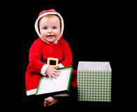 Baby girl in christmas costume Stock Images