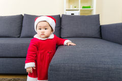 Baby girl with christmas dressing and learn standing Stock Photo