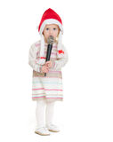 Baby girl in Christmas hat using microphone Royalty Free Stock Images