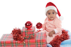 Baby girl with christmas presents Royalty Free Stock Photography