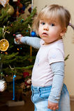 Baby girl with Christmas tree Royalty Free Stock Images