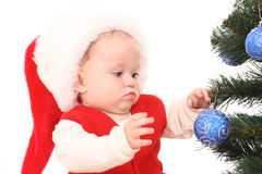 Baby girl and Christmas tree Royalty Free Stock Images