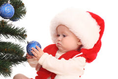 Baby girl and Christmas tree Royalty Free Stock Photography