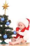 Baby girl and Christmas tree Royalty Free Stock Image