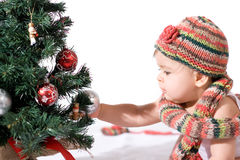 Baby girl with christmas tree Royalty Free Stock Image