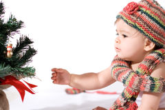Baby girl with christmas tree Stock Photo