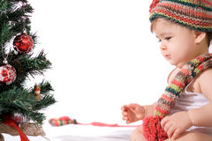 Baby girl with christmas tree Stock Photography