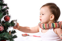 Baby girl with christmas tree Royalty Free Stock Photos