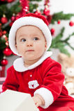 Baby girl and christmas tree - closeup Royalty Free Stock Photo
