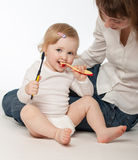 Baby girl cleaning her teeth Royalty Free Stock Photography