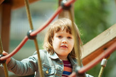 Baby girl climbing at ropes Royalty Free Stock Photo