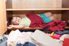 Baby girl is in the closet. At home Royalty Free Stock Photography