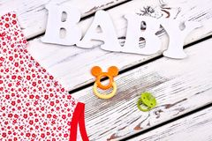 Baby-girl clothes and accessory. Stock Photo