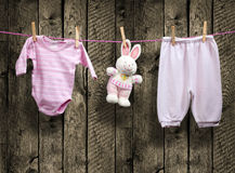 Baby girl clothes and bunny on a clothesline Stock Image