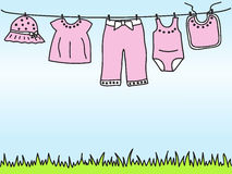 Baby girl clothes on clothesline Royalty Free Stock Image