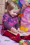 Baby girl collecting puzzle Stock Images