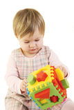 Baby girl with colorful sorter toy royalty free stock photos