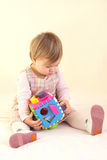 Baby girl with colorful sorter toy Royalty Free Stock Photography
