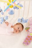 Baby girl with colorful toys Royalty Free Stock Photography