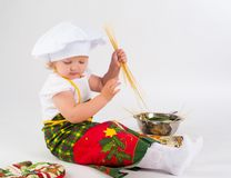 Baby girl in the cook hat Royalty Free Stock Images