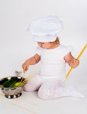 Baby girl in the cook hat Stock Photo