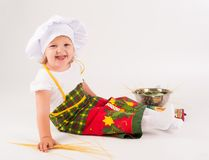 Baby girl in the cook hat Royalty Free Stock Photos