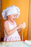 Baby girl in cook role Royalty Free Stock Photography