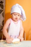 Baby girl in cook role Stock Images