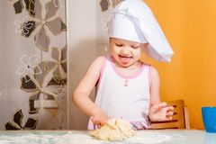 Baby girl in cook role Royalty Free Stock Image