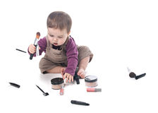 Baby girl with cosmetics Stock Images