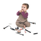 Baby girl with cosmetics Stock Photo
