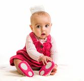 Baby girl in costume princess. Cute six-month girl in costume princess royalty free stock photos