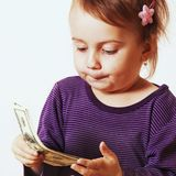 Baby girl counting money. Dollars. success, wealth management. Royalty Free Stock Image