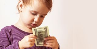 Baby girl counting money. Dollars. success, wealth management. Royalty Free Stock Photo