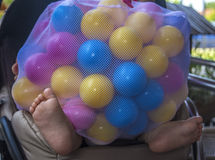 Baby girl covered by balls Royalty Free Stock Photos