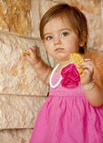 Baby Girl With Cracker Royalty Free Stock Photos