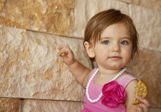 Baby Girl With Cracker Royalty Free Stock Photo