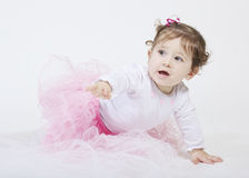 Baby girl crawling Stock Images