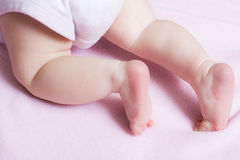 Baby girl crawling away on a blanket Royalty Free Stock Photos
