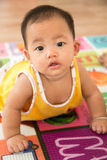 Baby girl crawling. Baby girl crawl practice at home , cheer up Royalty Free Stock Photos