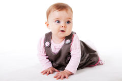 Baby Girl Crawling on the Floor royalty free stock photos