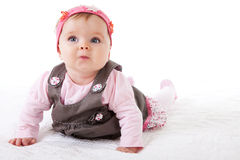 Baby Girl Crawling On The Floor Stock Photo