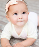Baby girl crawling outside Royalty Free Stock Images