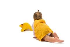 Baby Girl Crawling Towards Toy Stock Photo
