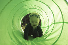 Baby Girl Crawling in the Toy Tunnel Royalty Free Stock Image