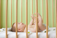 Baby girl in a crib Royalty Free Stock Photography