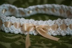 Baby girl crocheted head band with beige ribbon royalty free stock images