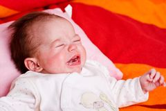 Baby girl and crying. Baby girl lying on a soft blanket and crying Royalty Free Stock Photography